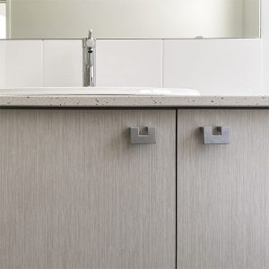 Polished chrome tapware and grey cabinetry
