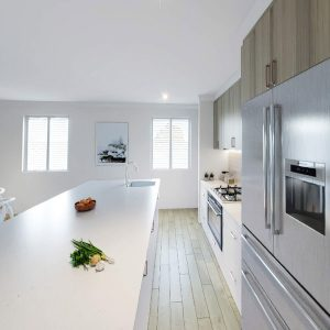 kitchen with island, stove and refrigerator