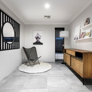 indoor space with lounge chair, shelves, and white rug