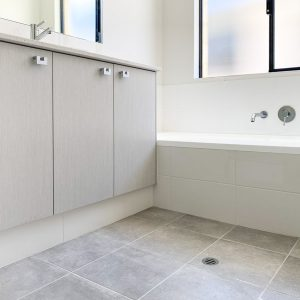 grey bathroom tiles with grey shelves